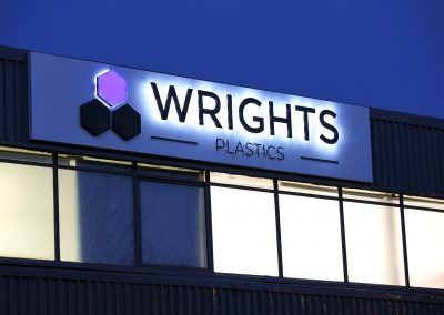 Illuminated outdoor sign for Wrights Plastics West Bromwich premises